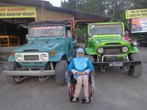 Wheelchair user in front of 2 jeeps at lava tour Mount Merapi Yogyakarta
